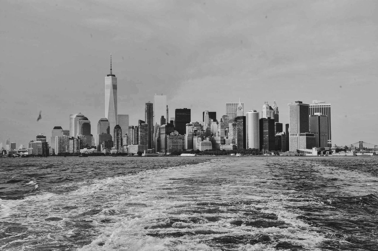 East River Against One World Trade Amidst Towers