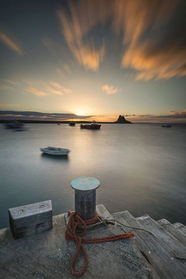 Morning Glory | Happy Worldphotographyday everyone ;) Lindisfarne Northumberland Holy Island Sunrise Sunlight Sea And Sky Seaview Sea & Sky Clouds And Sky Great Britain Seascape Long Exposure Pivotal Ideas Color Palette Fine Art Photography Nature Photography Castle Boats And Sea Boats And Clouds Sky_collection Skyporn (null)Landscape_photography EyeEm Masterclass