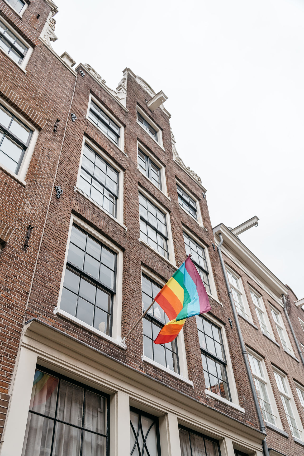 Beautiful stock photos of homosexuell, low angle view, flag, patriotism, building exterior