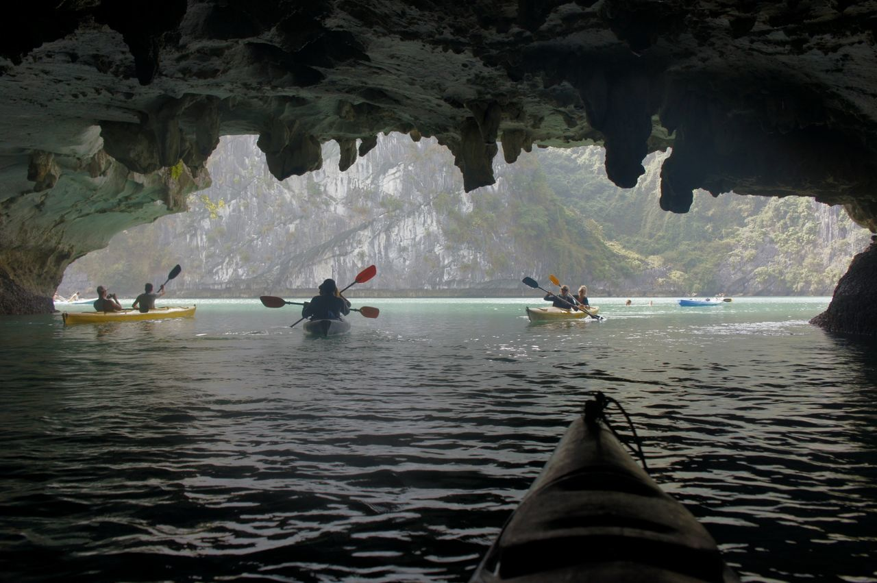 Adult Adventure Astrology Sign Beauty In Nature Cave Day Halong Halong Bay Vietnam Halongbay Kayaking Nature Nautical Vessel Outdoors People Rock - Object Sea Water