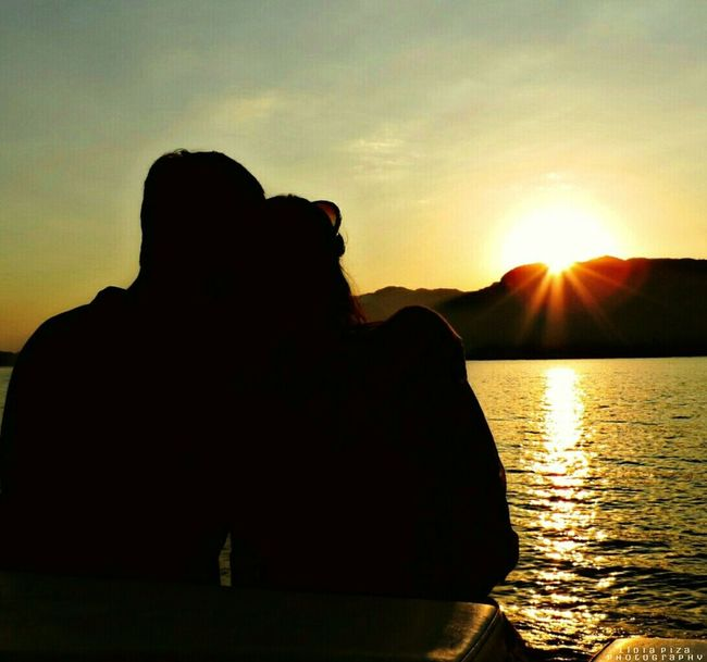 My Favorite Place Sunset Silhouette Sun Water Sea Beach Love Taking Photos Watching The Sunset Tranquil Scene Scenics Tranquility Lake Sunbeam Sunlight Reflection Beauty In Nature Back Lit Mountain Idyllic Lens Flare Nature Lakeshore Ilhabela Vacations