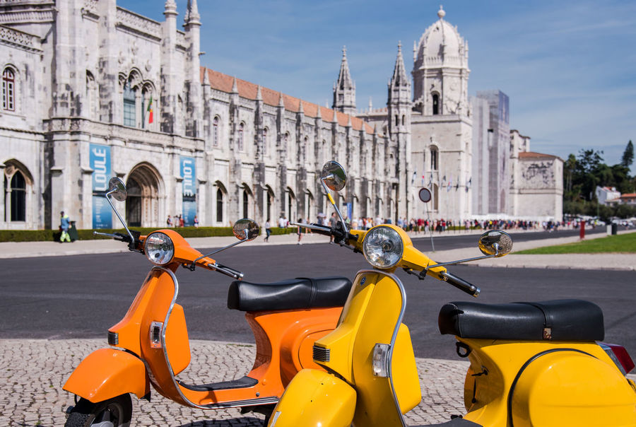 Belém City City Life Colourful Scooter Transportation Travel Travel Photography Traveling Vespa Architecture Building Exterior Built Structure Day History Jeronimos Monastery Land Vehicle Lifestyles Lisbon Mode Of Transport Outdoors Scooter Sunlight Transportation Travel Destinations