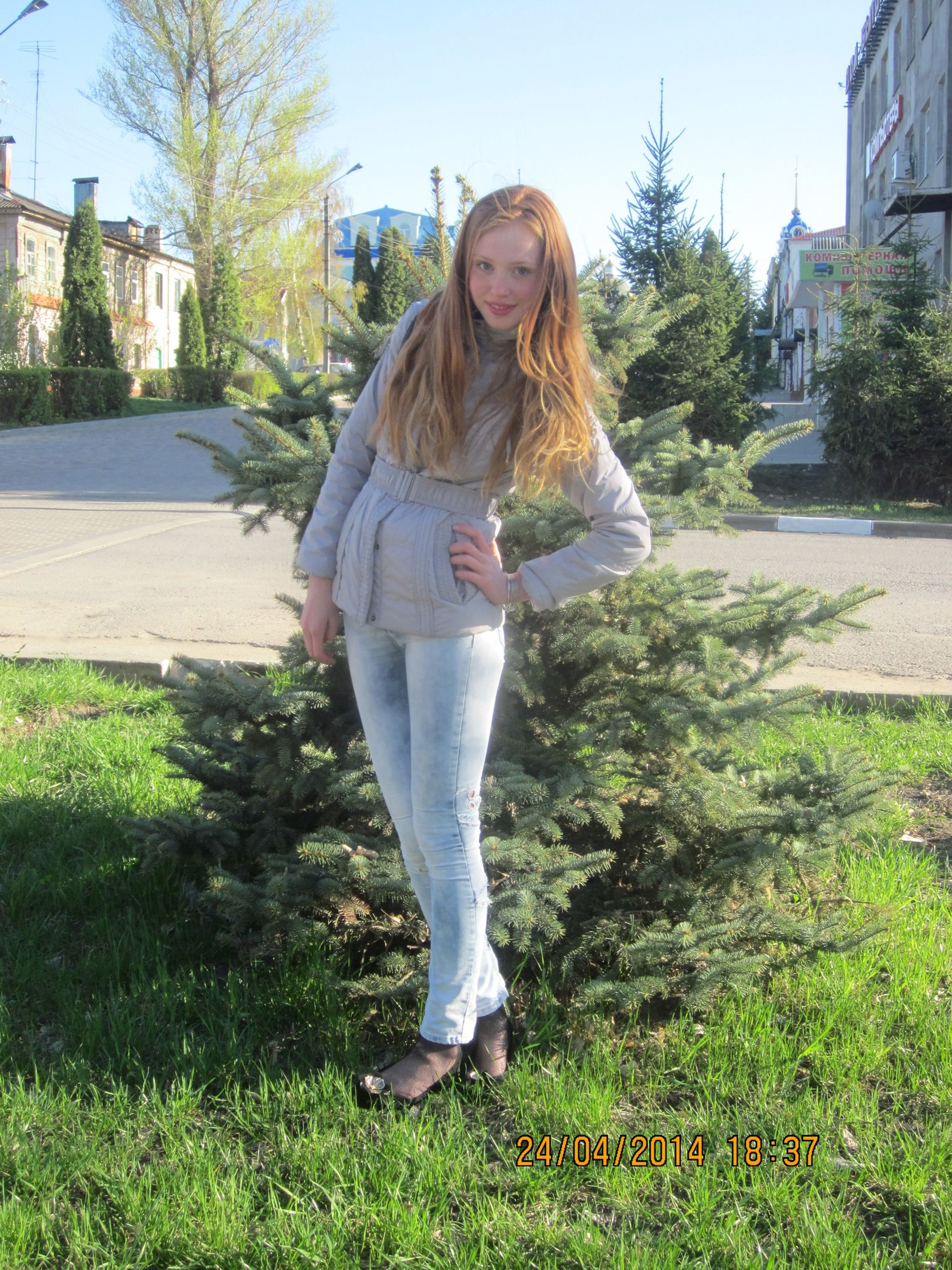 young adult, person, casual clothing, grass, young women, lifestyles, standing, full length, front view, portrait, leisure activity, looking at camera, long hair, building exterior, tree, built structure, sunglasses