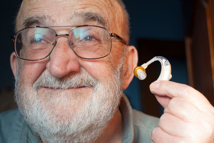 old man with hearing aid Beard Close-up Communication Deaf Deafness Device Disabled Ear Equipment Eyeglasses  Gray Hair Health Healthcare Hearing Aid Help Human Man Medical Care Medicine Old People Portrait Senior Men Technology Wellbeing
