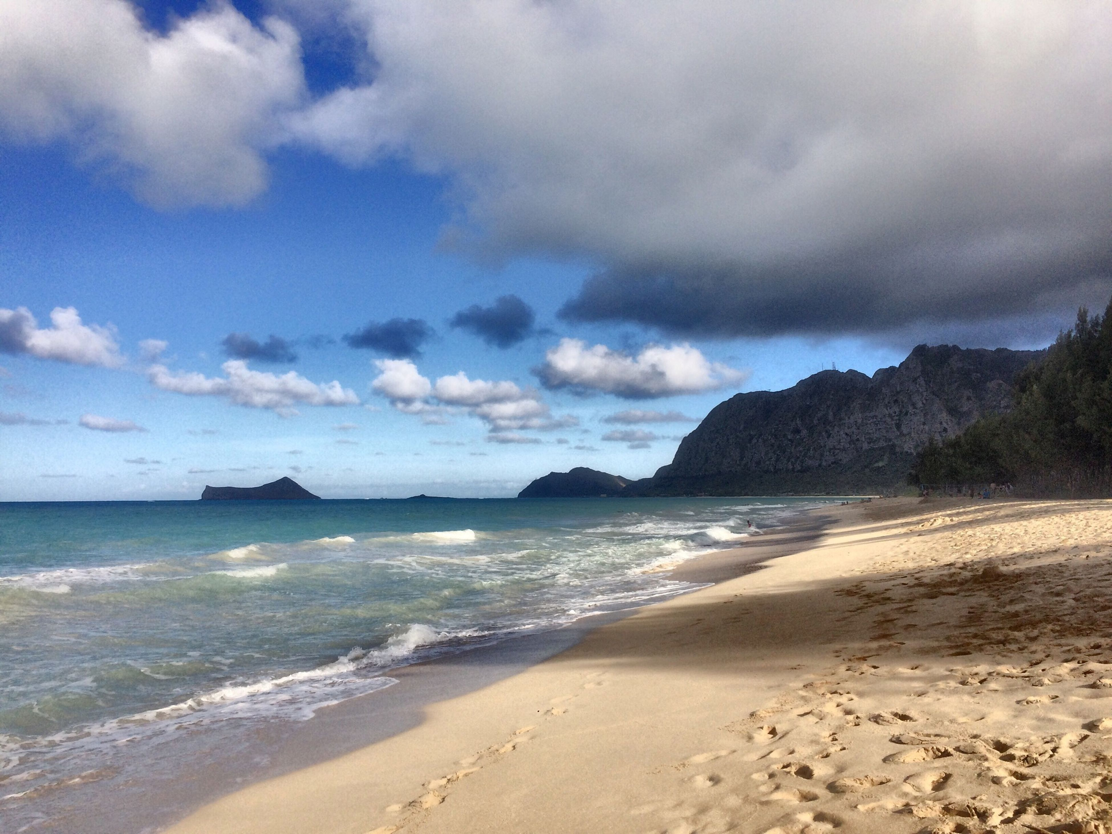 sea, beach, water, sky, shore, scenics, tranquil scene, tranquility, beauty in nature, cloud - sky, sand, horizon over water, nature, cloudy, cloud, coastline, idyllic, wave, mountain, remote