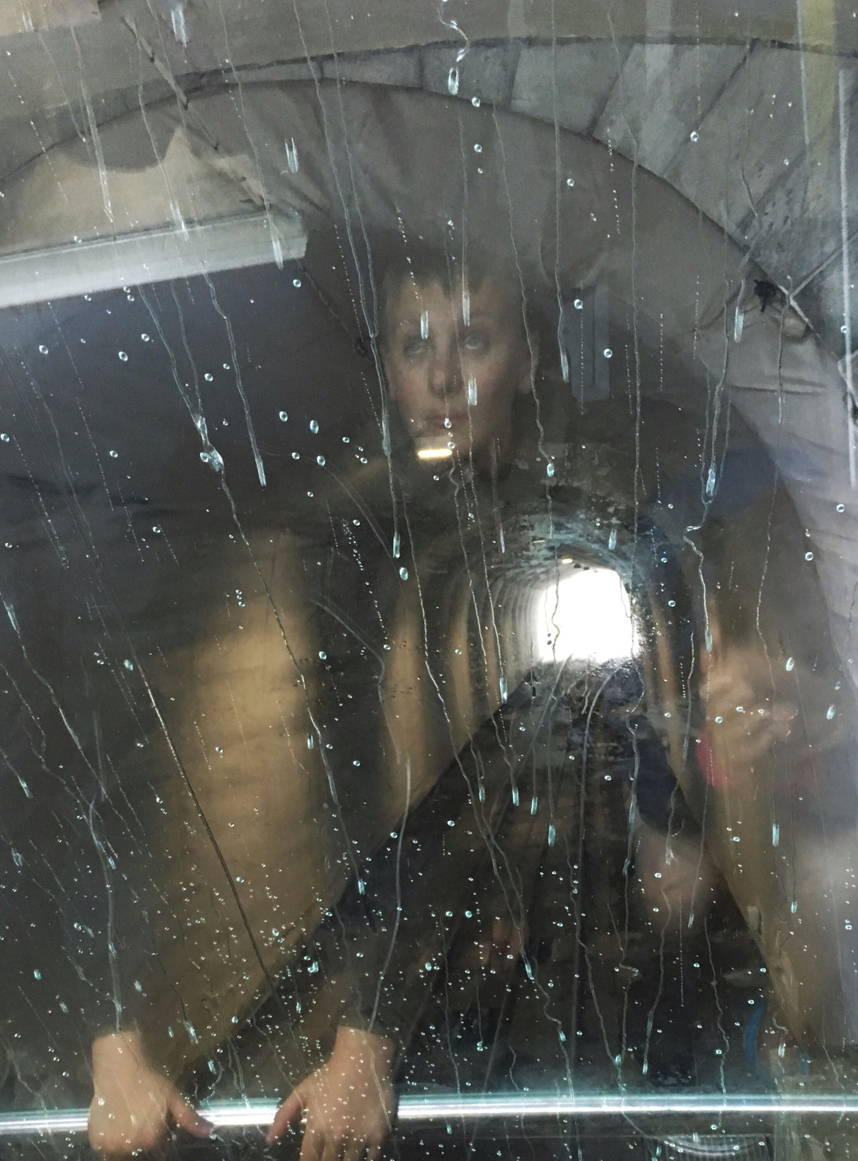 transparent, window, adults only, mid adult, looking through window, one person, adult, wet, people, only women, one woman only, day, indoors, real people, young adult, water, close-up