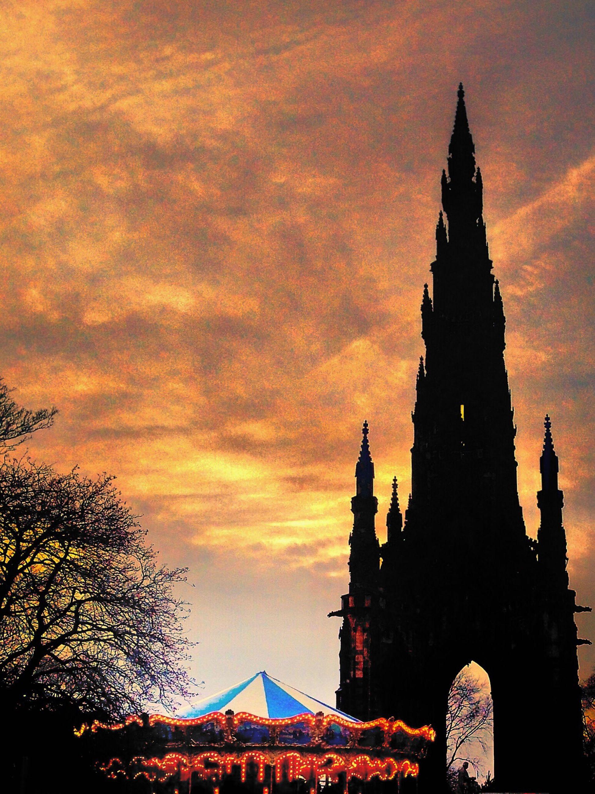 architecture, sunset, building exterior, silhouette, built structure, orange color, no people, sky, travel destinations, place of worship, cloud - sky, city, outdoors
