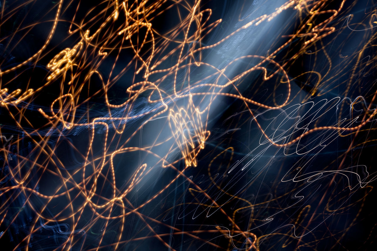 Scribble of light Backgrounds Beauty In Nature Close-up Illuminated Lightning Lights In The Dark Long Exposure Motion Nature Night No People Outdoors Scribble Sky Sparks Wire Wool