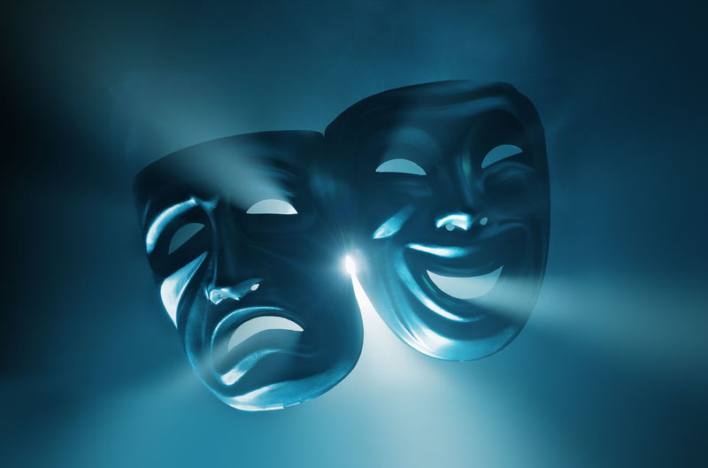 Crying and smiling masks in hazy light. Emotions Feeling Laughing Light Smoke Smoky Theater Blue Contrast Cyan Emotion Entertainment Feelings Glad Hazy  Mood Moodswing Moodswings Moody Object Opposite Opposites Smiling Spotlight Theatre