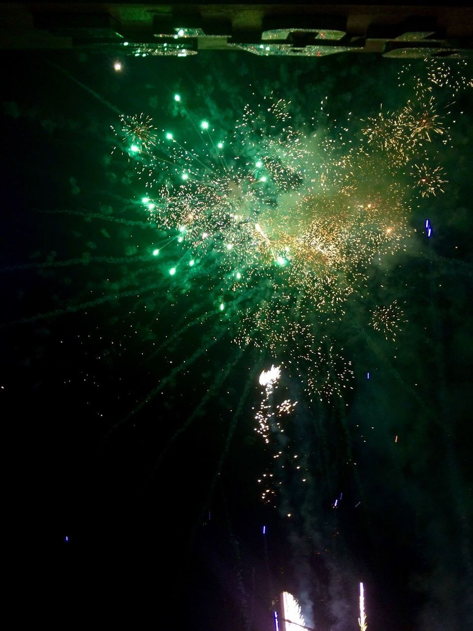 1/1/17 My Year My View No People No Filter, No Edit, Just Photography No Edit No Filter Photography Original Photo Shot From Below Front Camera Fireworks 🎆 Green Color 💚 Sky Outdoors Exploding Celebration Arts Culture And Entertainment Night 🌌 Illuminated ShotOnIphone 📱 Philippines 🇵🇭 Adapted To The City Carnival Crowds And Details Welcome To Black