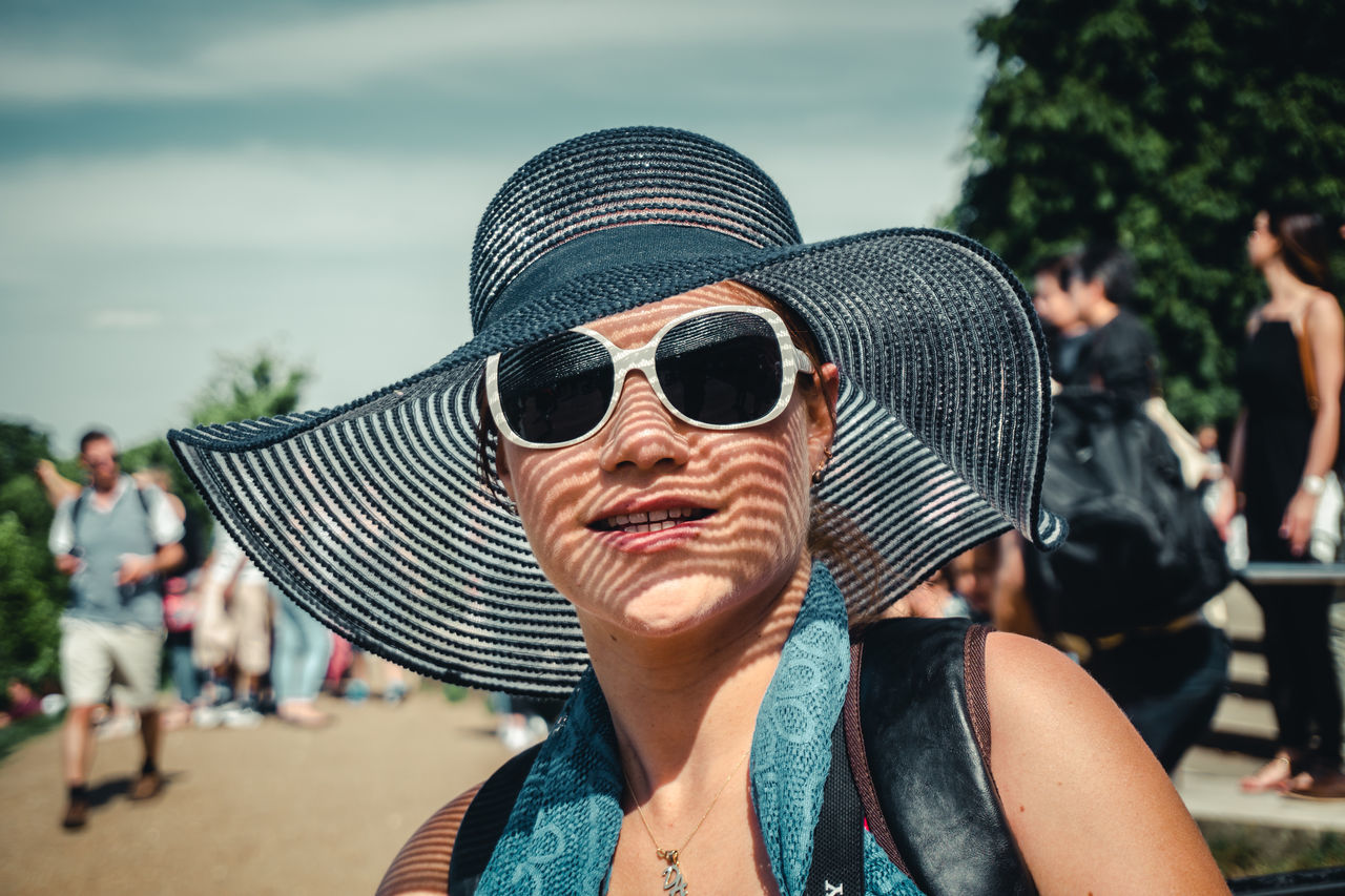 Day Focus On Foreground Headshot Incidental People Lifestyles Looking At Camera Outdoors Portrait Sunglasses Sunlight The Portraitist - 2017 EyeEm Awards Young Adult Young Women