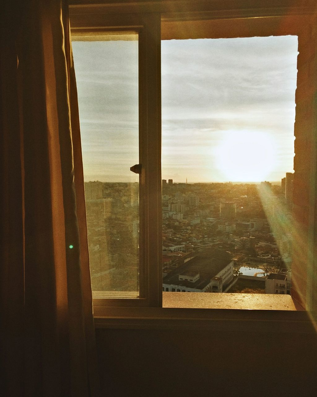 window, sky, indoors, sun, sunlight, built structure, looking through window, no people, day, architecture, building exterior, cityscape, nature, close-up