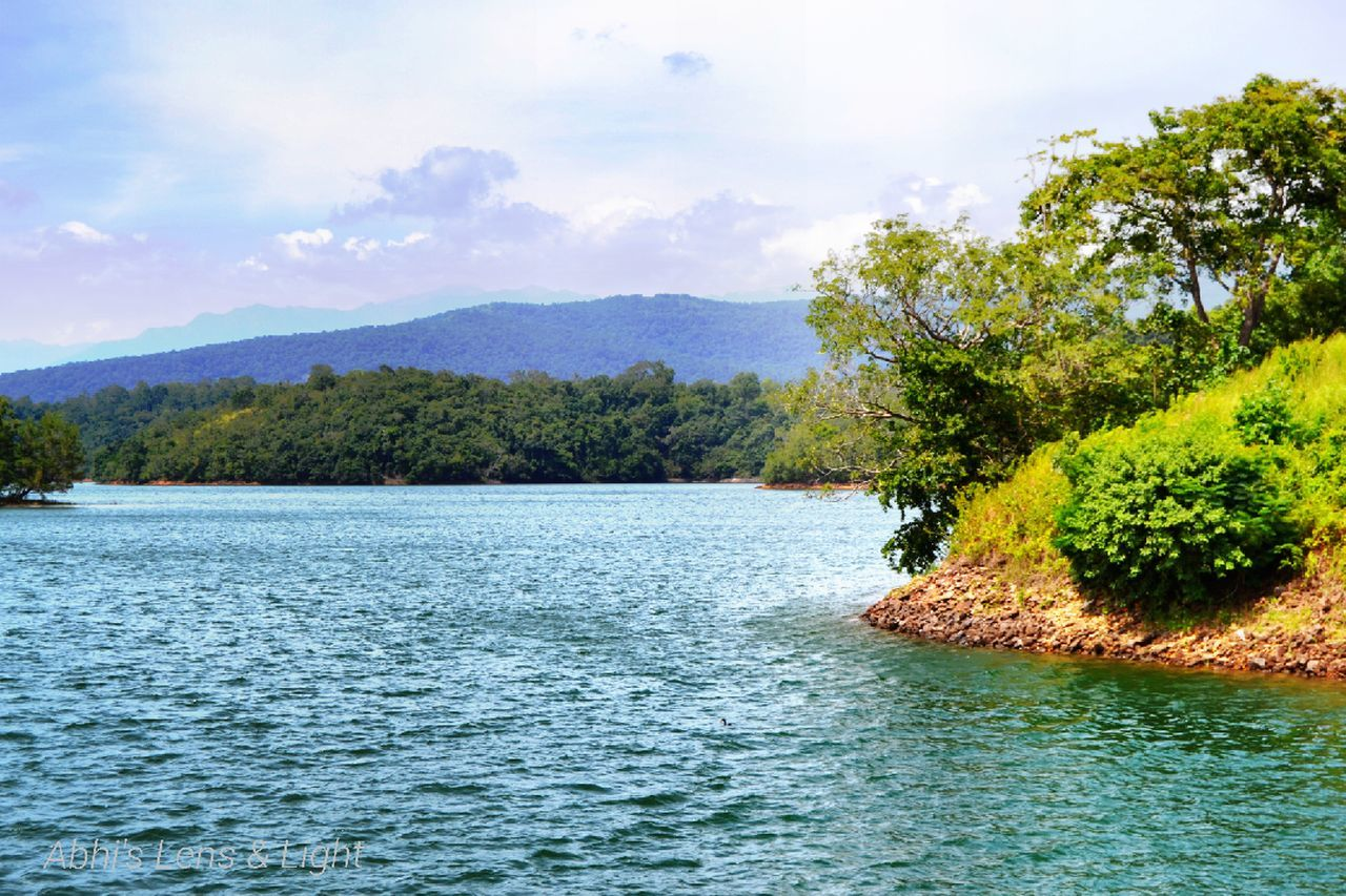 Beauty of Neyyar Dam, Kerala Neyyardam NikonD3100 Dam Beautiful Scenery Picoftheday River Nature Calm Green Color Outdoors Scenics Tree Beauty In Nature Water Sky Green Green Green!  Relaxing Kerala India God's Own Country Incredible India