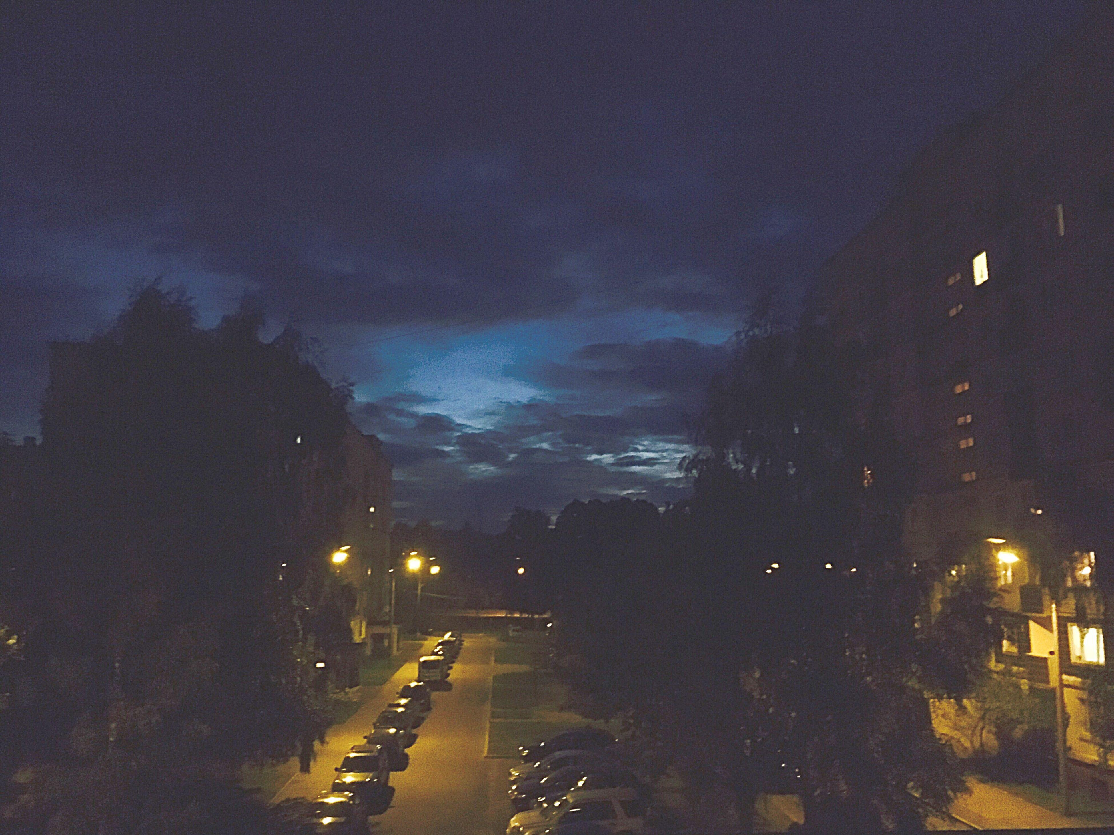 night, illuminated, sky, transportation, street, car, water, road, mode of transport, street light, built structure, building exterior, land vehicle, city, dusk, weather, architecture, wet, lighting equipment, rain
