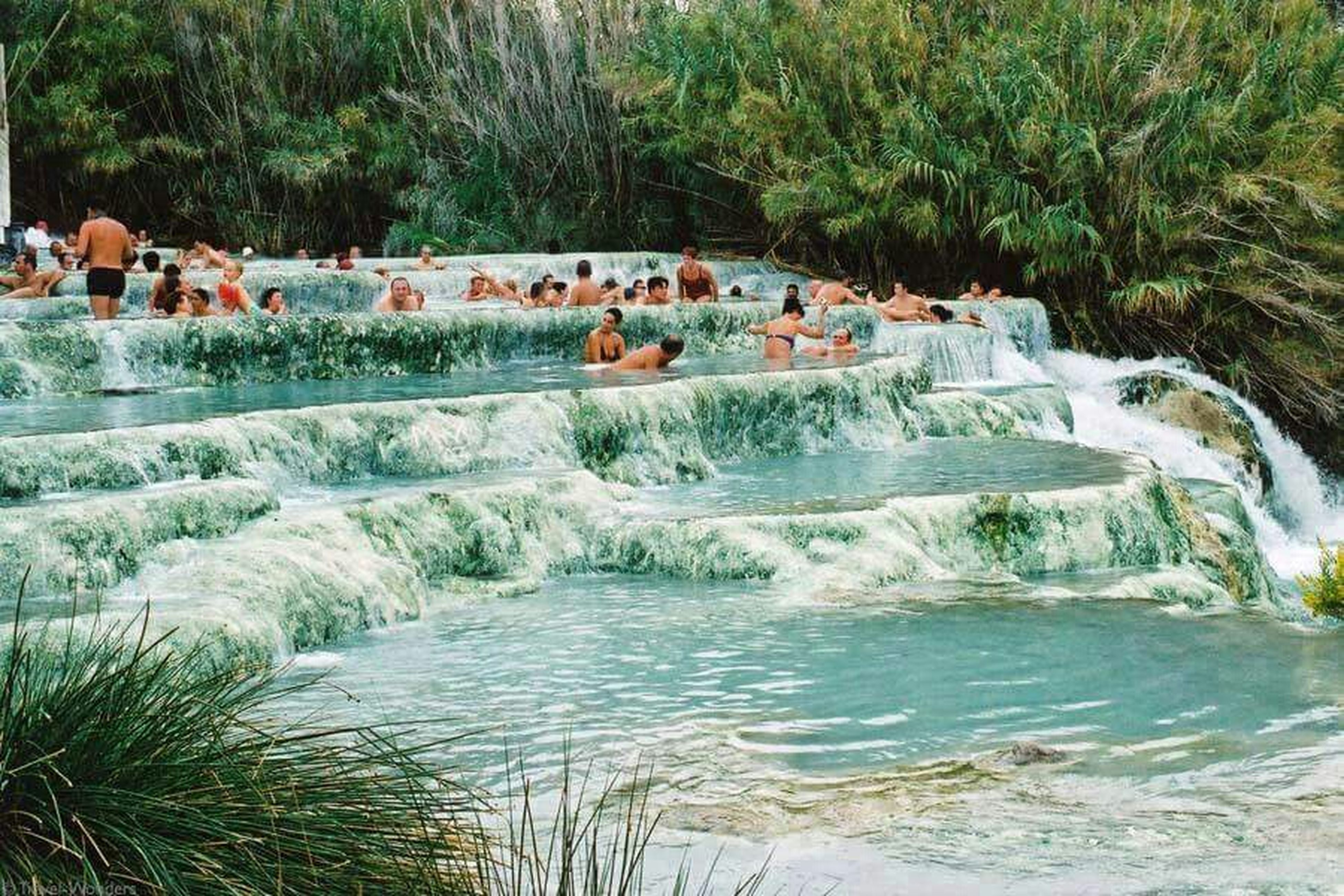 water, lifestyles, leisure activity, men, large group of people, tree, person, vacations, medium group of people, waterfront, nature, enjoyment, tourist, motion, river, beauty in nature, tourism, mixed age range, day