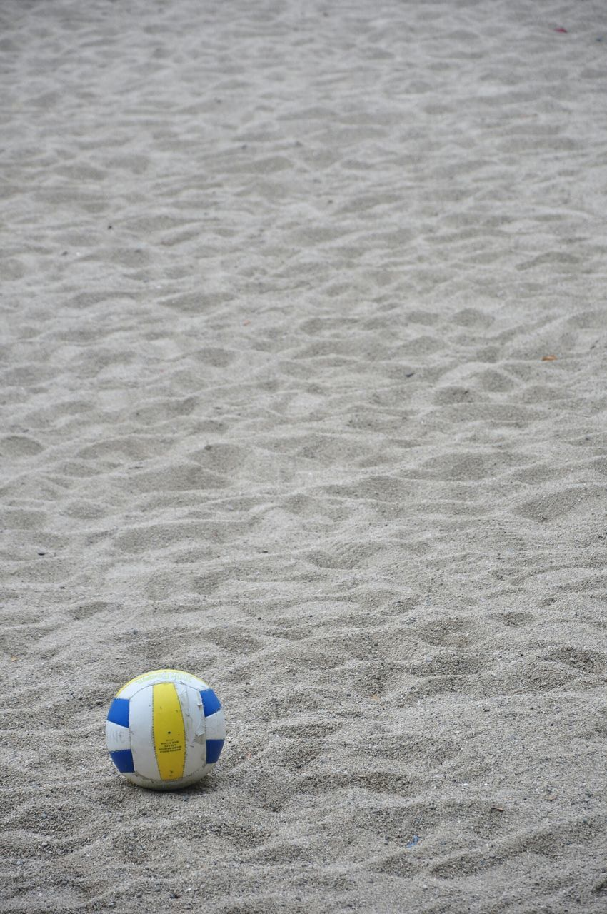 High Angle View Of Volleyball On Sandy Beach