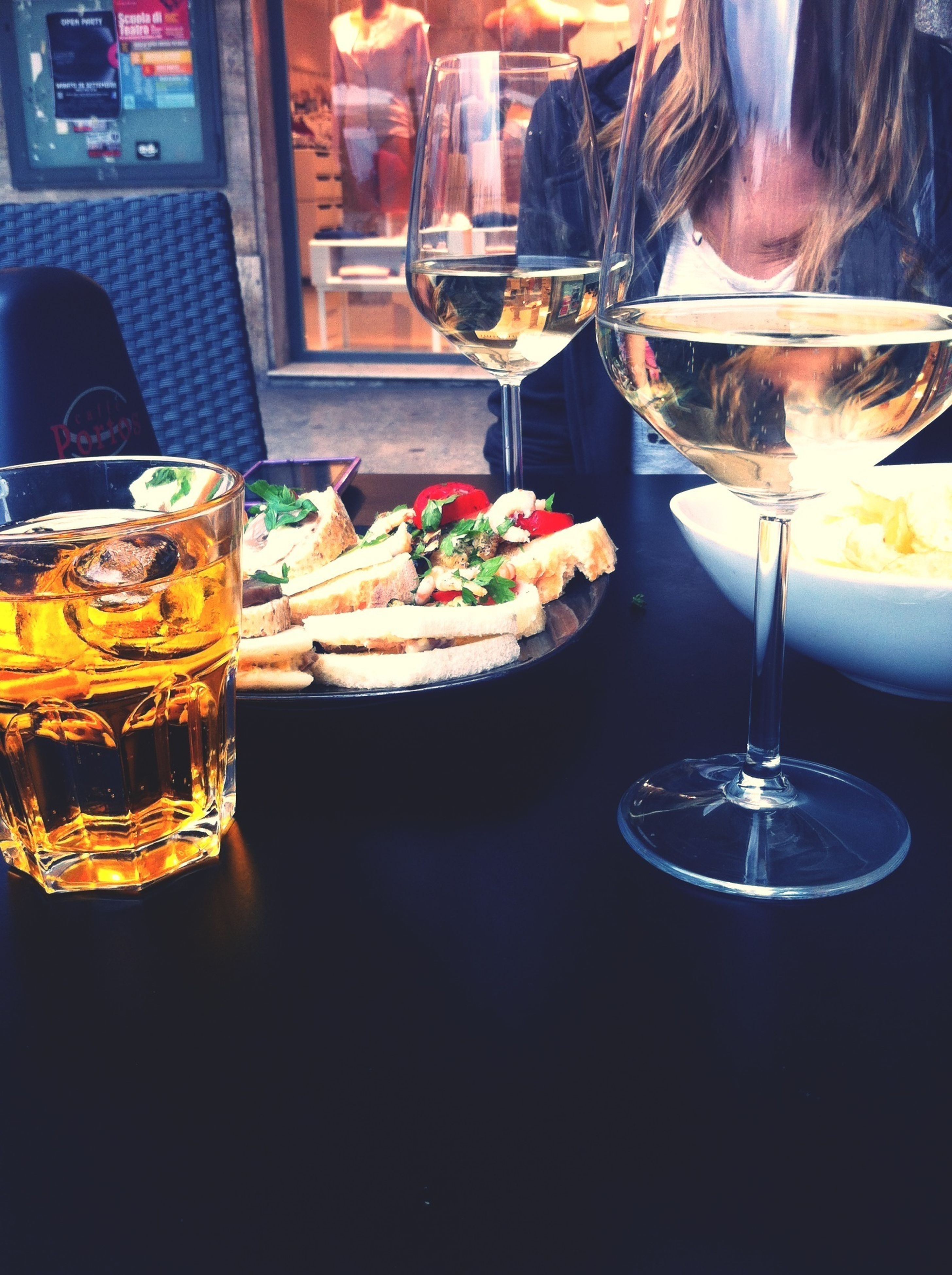 food and drink, indoors, drinking glass, table, drink, freshness, restaurant, wineglass, food, refreshment, glass - material, wine, alcohol, plate, glass, lifestyles, transparent, dining table