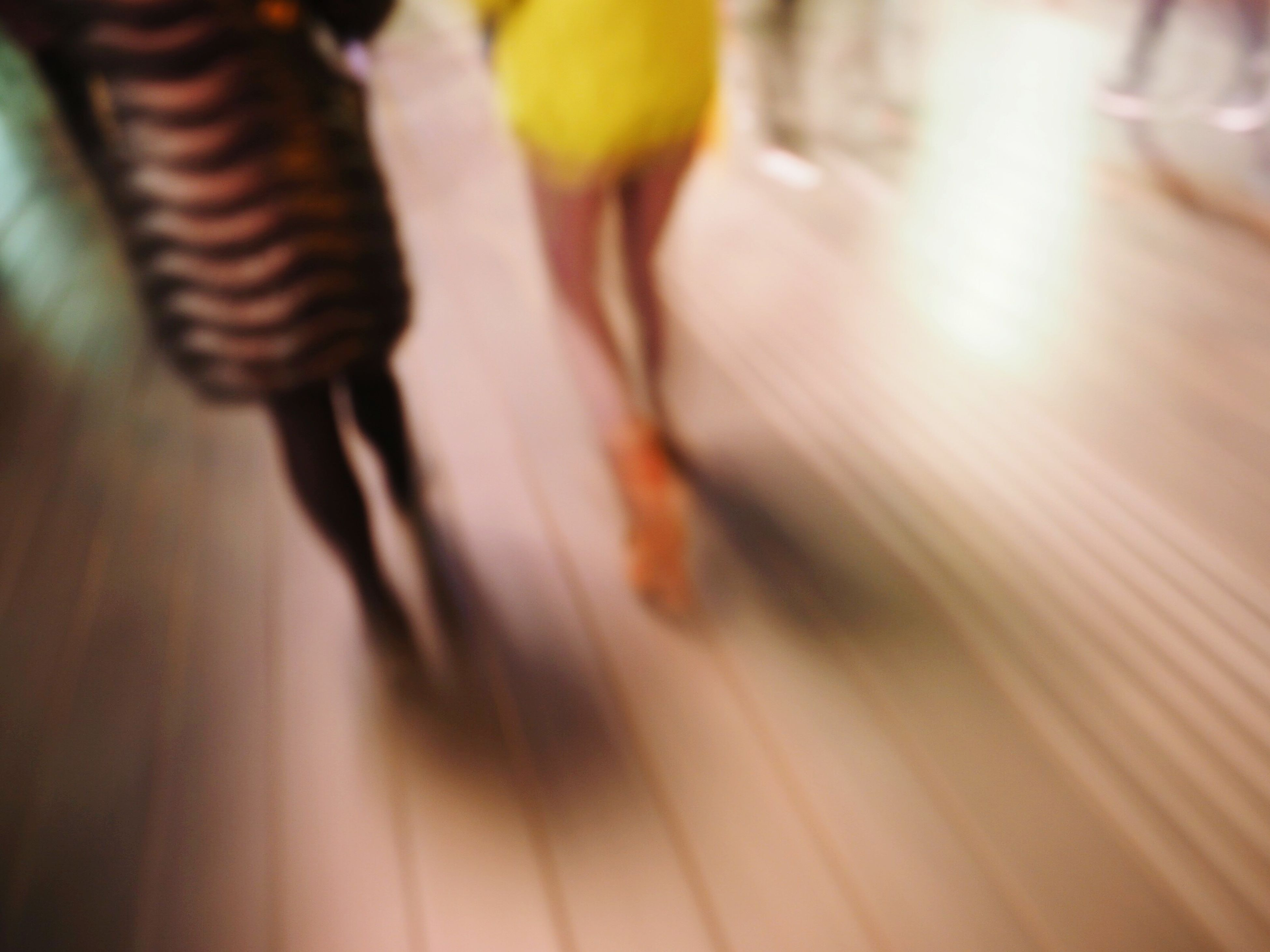indoors, selective focus, blurred motion, transportation, motion, close-up, focus on foreground, part of, road, street, high angle view, speed, mode of transport, on the move, travel, defocused, unrecognizable person, reflection