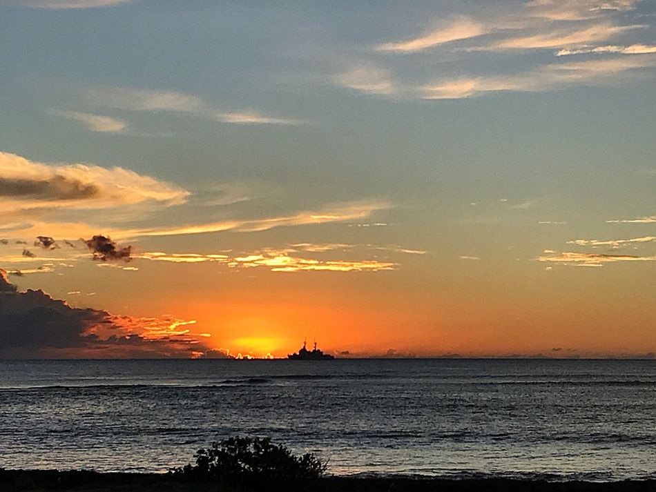 Sunset Sea Beauty In Nature Orange Color Scenics Sky Water Tranquil Scene Nature Tranquility Silhouette Beach Sun No People Outdoors Horizon Over Water Cloud - Sky Ship In Oahu United States