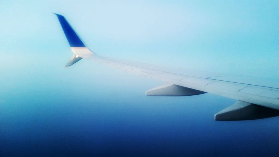 Airplane Blue Flying Aircraft Wing Transportation Aerial View Sky Mode Of Transport Clear Sky No People Air Vehicle Outdoors Nature Close-up Day Airplane Wing