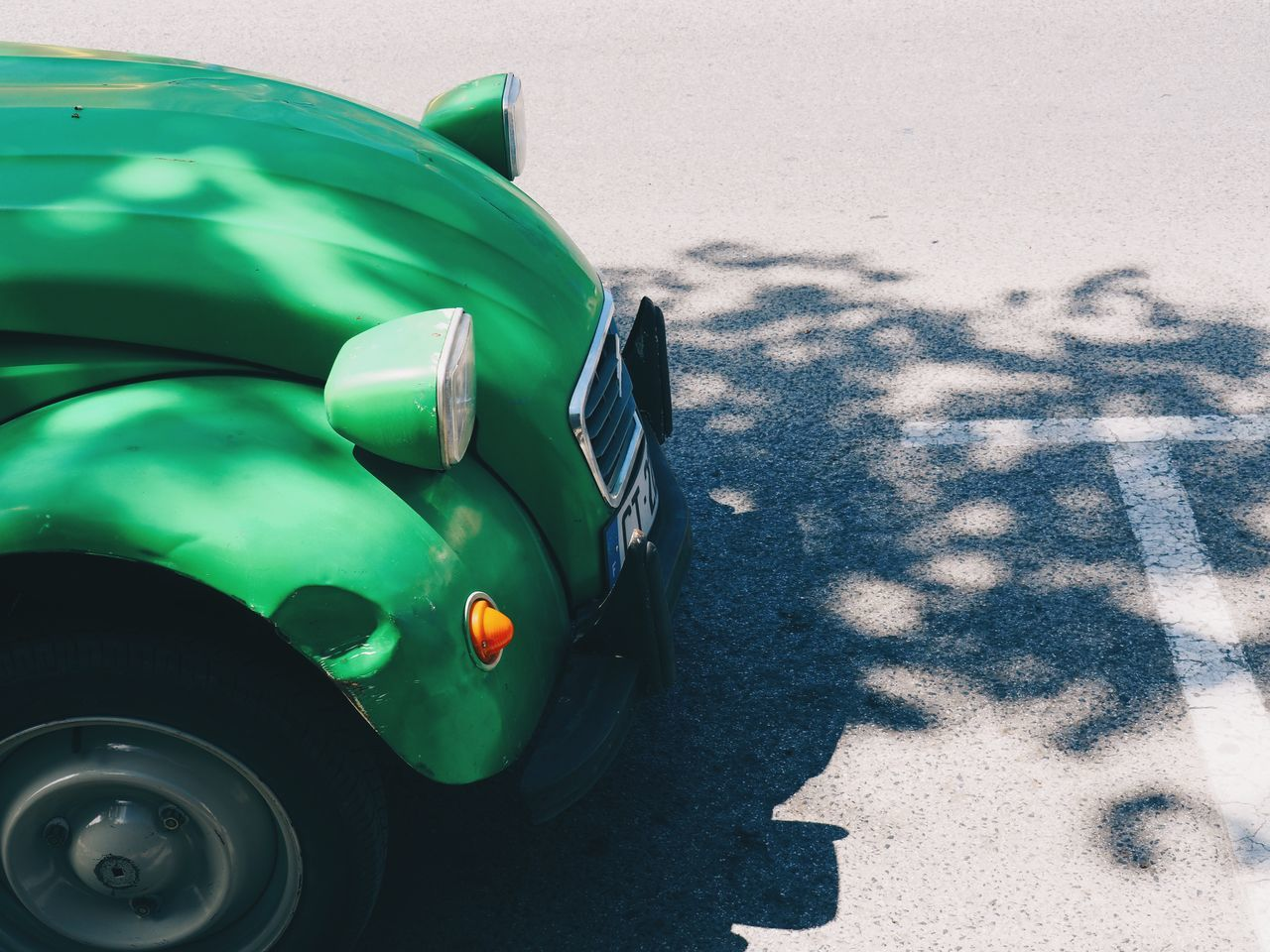 transportation, toy, mode of transport, car, land vehicle, green color, childhood, stationary, no people, day, road, shadow, outdoors, toy car, close-up, tire