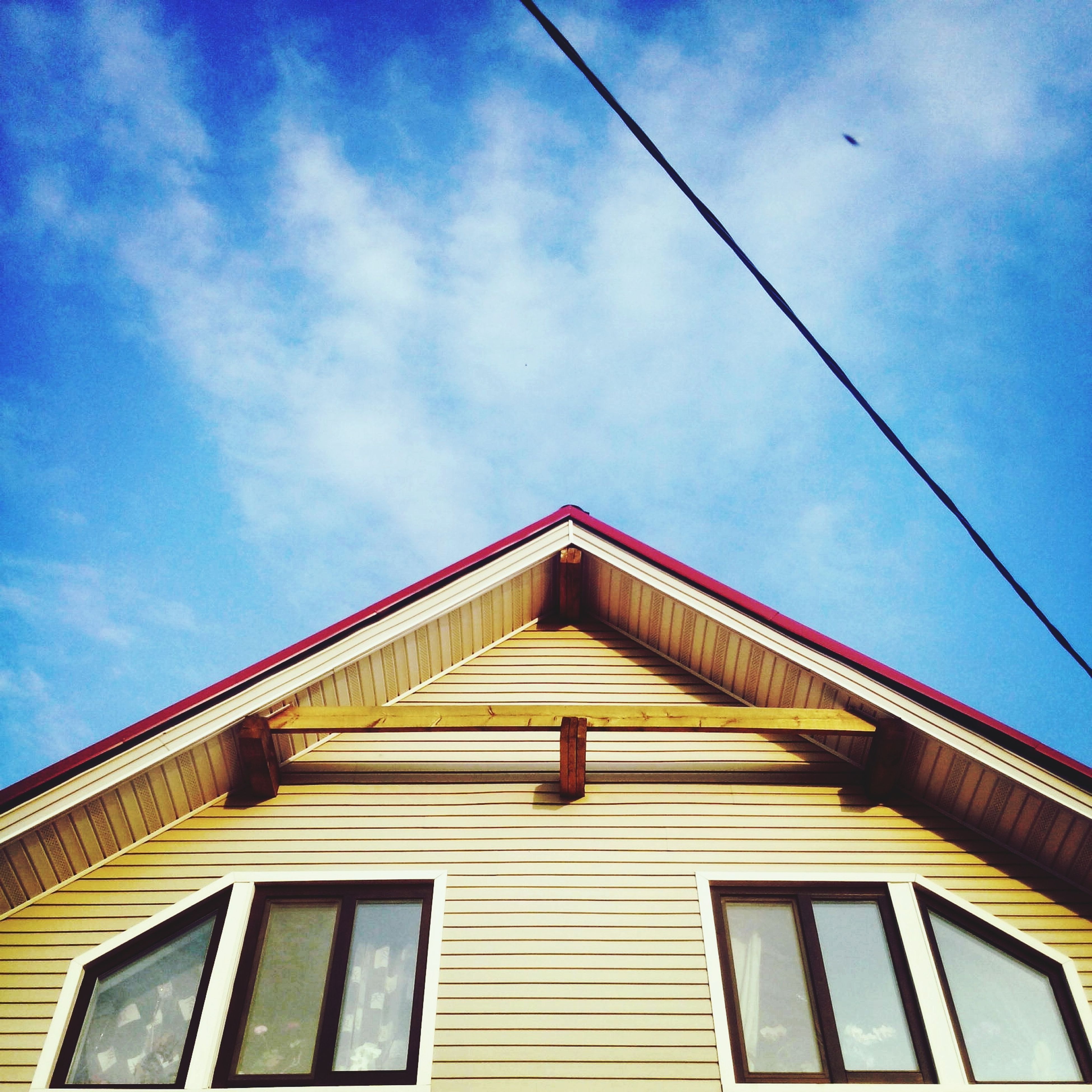 architecture, low angle view, built structure, building exterior, sky, blue, building, residential structure, cloud, residential building, window, cloud - sky, high section, day, outdoors, cable, no people, house, roof, power line