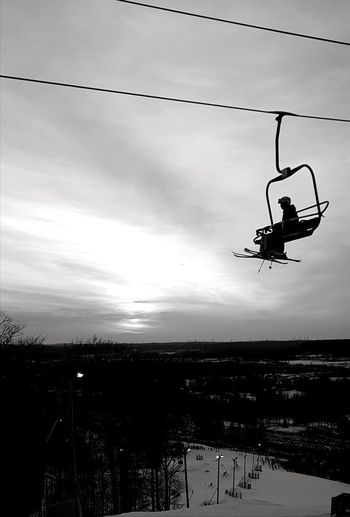 chair lift Skiing Monochrome Blackandwhite Contrast One Person Full Length One Man Only Danger Only Men Silhouette Sport Mid-air People Leisure Activity Adults Only Day Extreme Sports Sky Outdoors