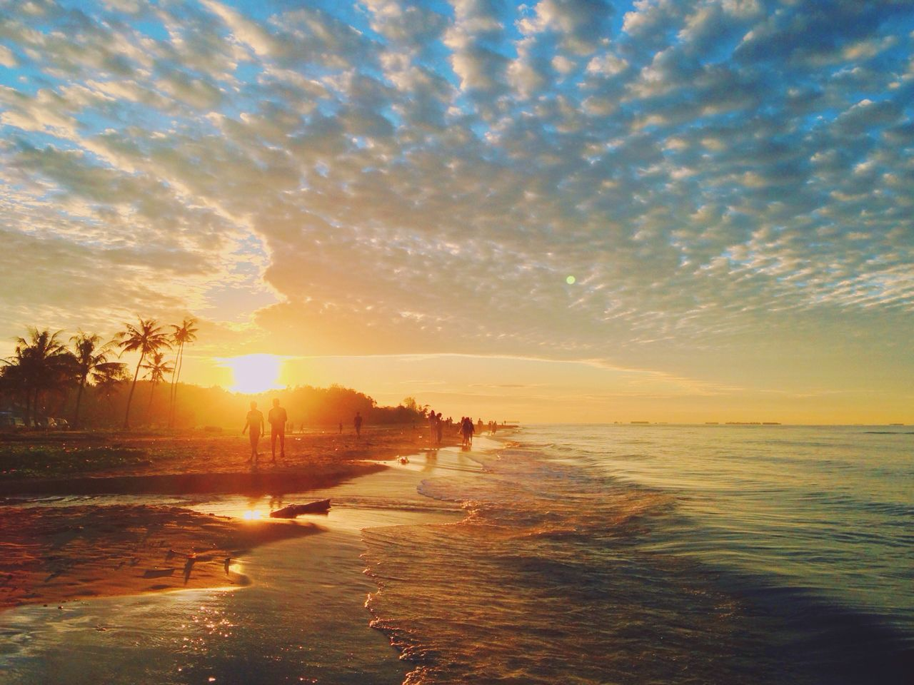 sunset, sun, sea, water, sky, scenics, beauty in nature, tranquil scene, orange color, tranquility, sunlight, nature, beach, cloud - sky, idyllic, silhouette, outdoors, reflection, horizon over water, no people, vacations, wave, tree, day