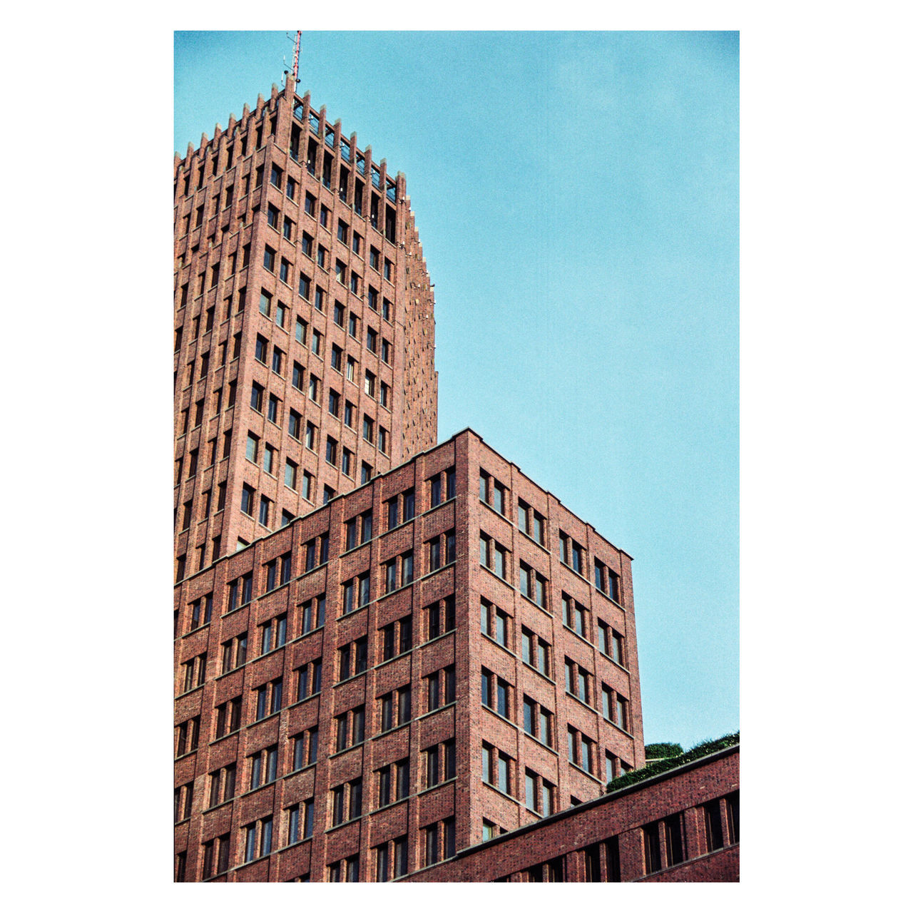 I don't like this part of Berlin. A place where people just go to work and that's it. Nothing important. Except it's the best place for movies in OV and for bit of architecture photography. Potsdamer Platz, Berlin | Canon EOS 3, Kodak Portra 160 | somewhere around 2015 35mm 35mm Film 35mmfilm Architecture Building Exterior Canon Eos 3 City Ishootfilm Ishootfilmsendmoney Kodak Kodak Portra160 Modern Skyscraper