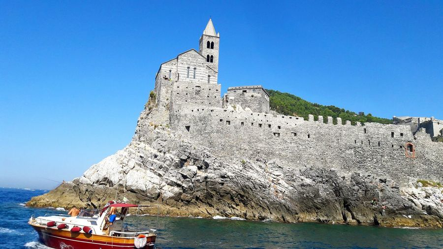 Porto Venere Water Sea Boat Nautical Vessel Transportation Clear Sky Tranquil Scene Blue Tranquility Tourism Scenics Travel Destinations Travel Mode Of Transport Nature Tourist Waterfront Beauty In Nature Fort Church