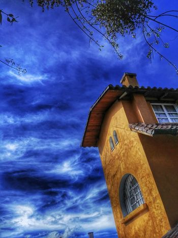 Architecture Built Structure Building Exterior Cloud - Sky Outdoors Low Angle View Sky No People Day Tree Nature Yellow House