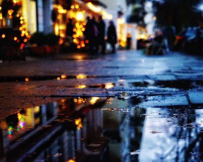 Puddles in Hamburg Ground Level View Reflections In The Water Wet Weather Water Illuminated Rain Rainy Season Reflection Night Street Puddle Outdoors Road Focus On Foreground Nature Car The Way Forward No People Winter Close-up City