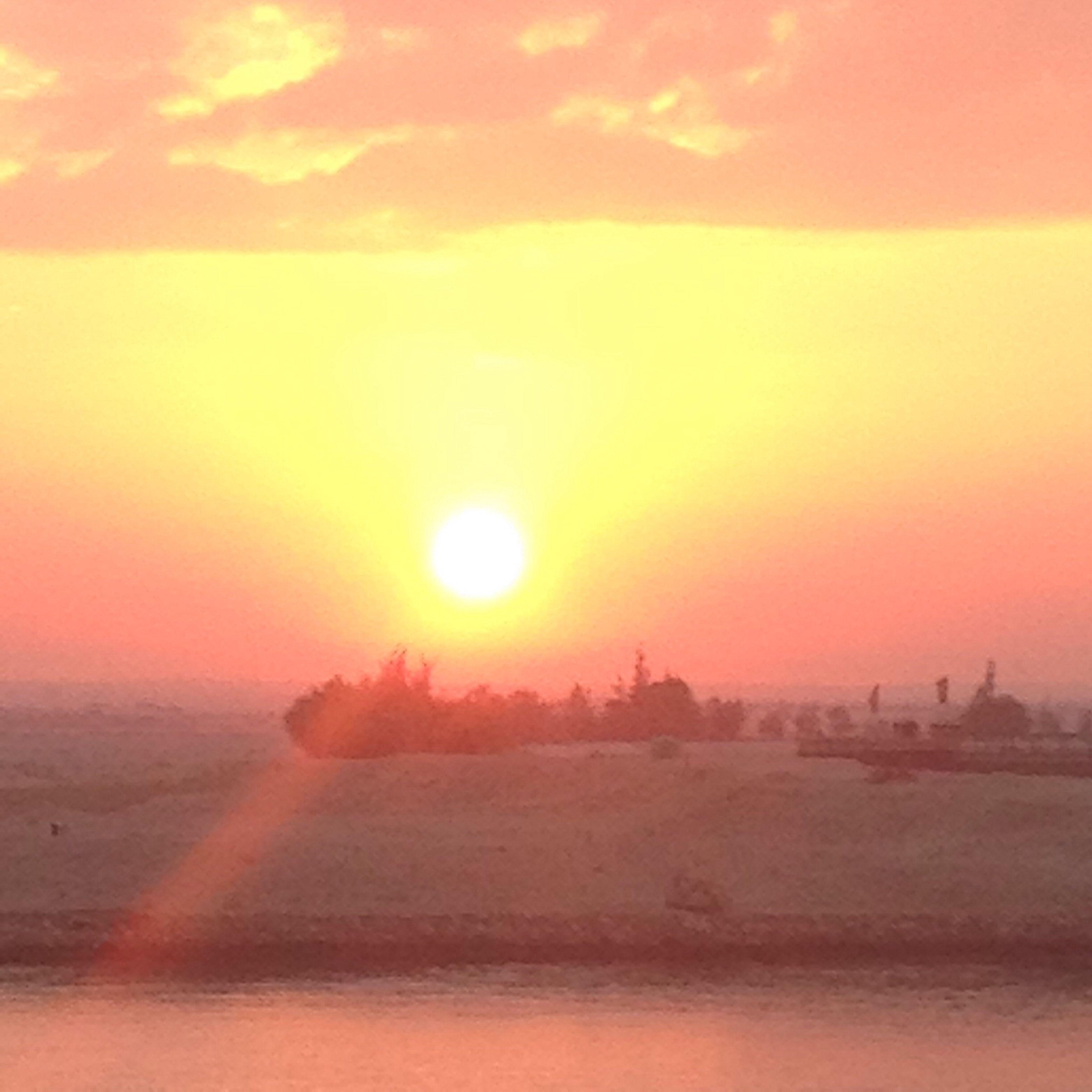 sunset, sun, orange color, scenics, tranquil scene, beauty in nature, tranquility, sky, idyllic, landscape, nature, sunlight, cloud - sky, sunbeam, outdoors, lens flare, dramatic sky, no people, remote, non-urban scene
