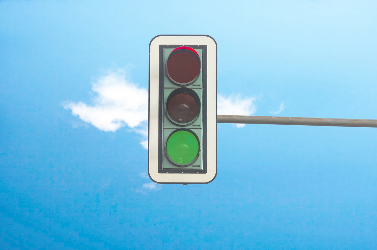 road sign, guidance, sky, stoplight, blue, transportation, day, communication, no people, red light, cloud - sky, green color, outdoors, railway signal, illuminated, close-up