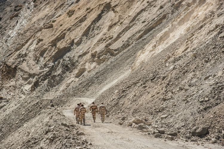 People And Places The brave soldiers can conquer any given terrain. Walking Full Length Nature Non-urban Scene Outdoors Tranquil Scene Beauty In Nature Person Mountain Footpath Nikon Himalayas Himachalpradesh Nikon D750 Soldiers Army Army Life India Indiapictures Travel Photography Braveheart Adventure Shotoftheday NikonAsia