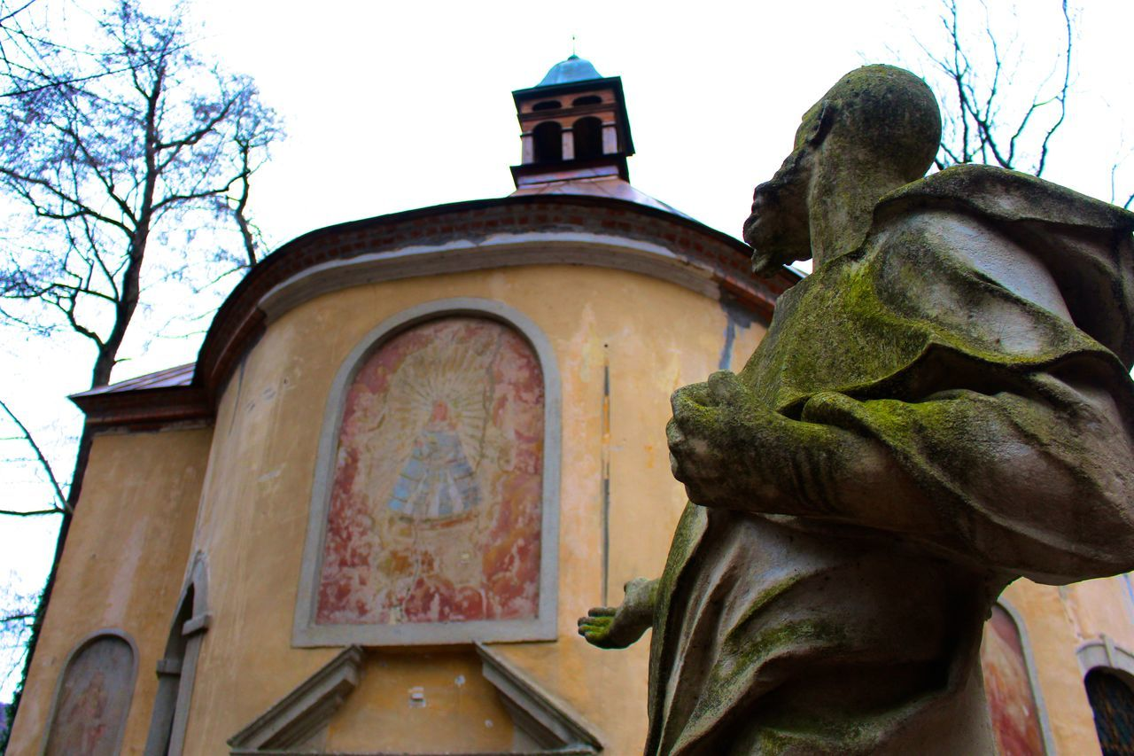 An 'angel' chapel and statue Angel Architecture Building Exterior Chapel Church Earth Colors History Low Angle View Moss Old Place Of Worship Religion Spirituality Statue