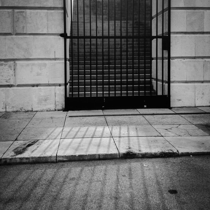 Light Fence Outdoors Myterious Bars Gate Door Closed Black And White Shine Through Daylight Urban Stone