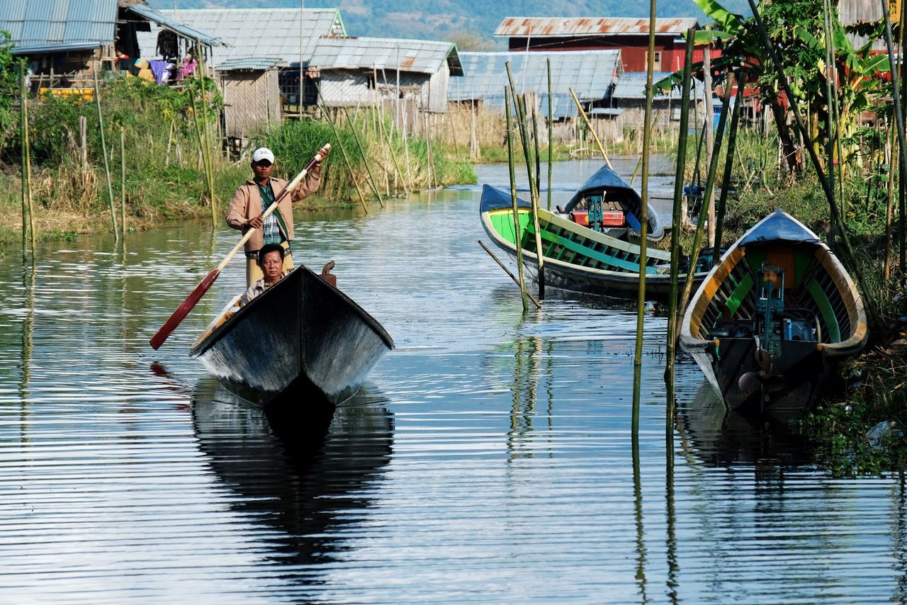 Nautical Vessel Mode Of Transport Water Transportation Real People Canal Travel Lifestyles Outdoors Travel Destination Travel Destinations Day People Adult Boat Reflection Reflections In The Water Gondolier Landscape EyeEm Best Shots EyeEm Gallery Check This Out Popular Photos in Inle Lake , Myanmar