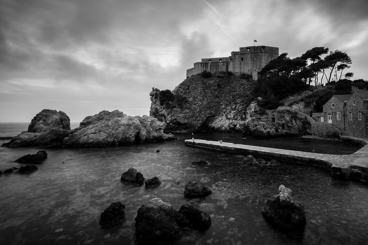 Blackwater Bay Adriatic Coast Architecture B&w Bay Black And White Blackandwhite Blackwater Built Structure Croatia Dubrovnik Game Of Thrones Jetty Long Exposure Lovrijenac Mono Monochrome ND Filter No People Outdoors Rock - Object Rocks Sky Water Waterfront Wide Angle