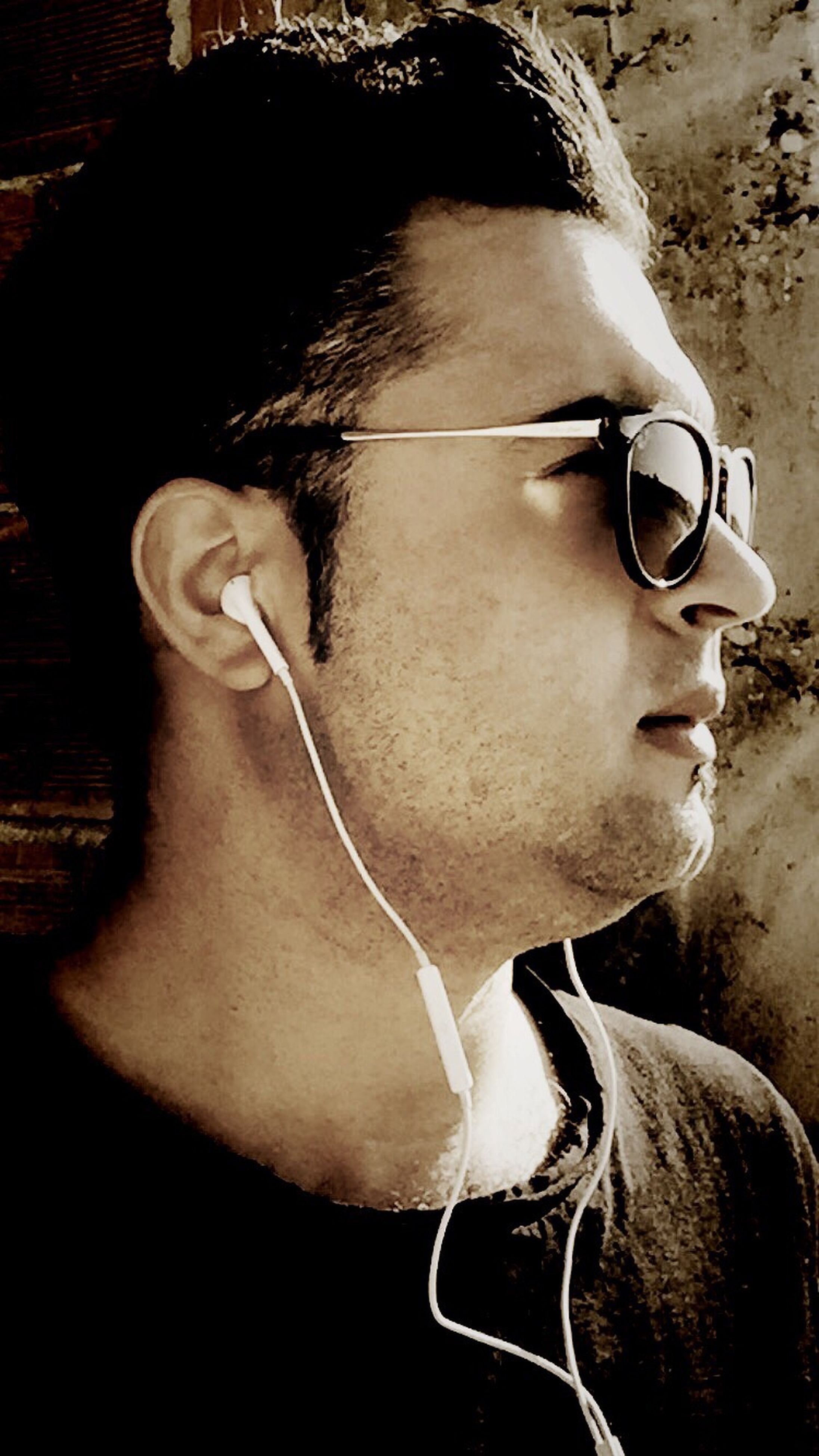 lifestyles, close-up, sunglasses, side view, holding, leisure activity, sunlight, young adult, men, front view, part of, person, headshot, cropped, outdoors, shadow, day