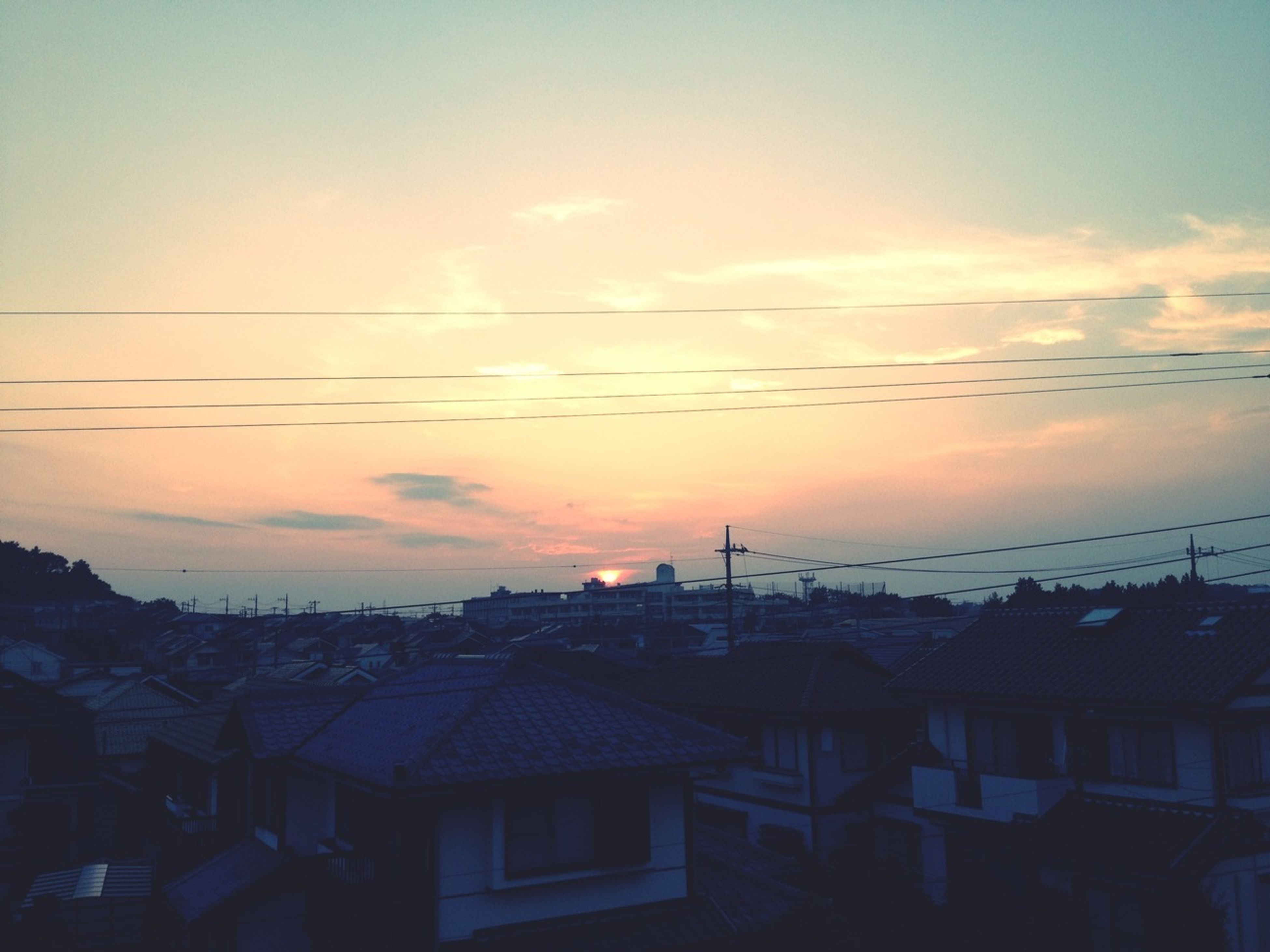 sunset, building exterior, architecture, built structure, sky, orange color, house, residential structure, cloud - sky, residential building, roof, silhouette, city, residential district, town, cloud, outdoors, no people, building, nature