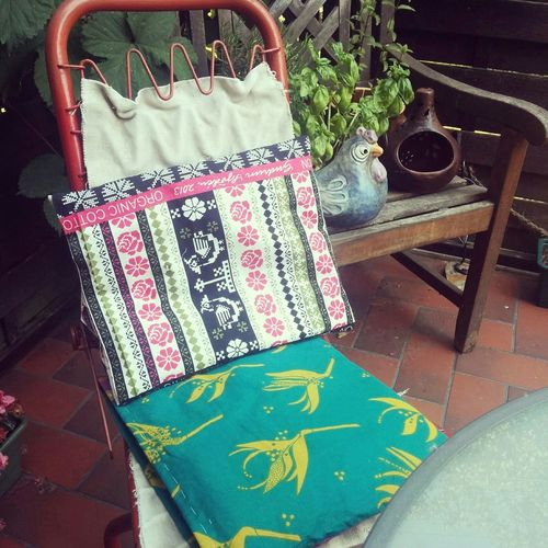 Mama started Sewing pillowsfor her Garden stools out of her huge collection of Gudrun Sjöden bags.