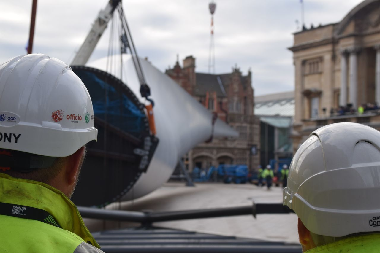 Siemens wind turbine blade is lifted into position in Hull's Queen Victoria Square (08/01/2017) during Hull 2017 City Of Culture Adult Adults Only Business Finance And Industry Close-up Day Headwear Hull Hull 2017 Hull City Of Culture 2017 Hull2017 Men Nautical Vessel Occupation One Man Only One Person Only Men Outdoors People Protective Workwear Sailing Sea Siemens  Skill  Workers