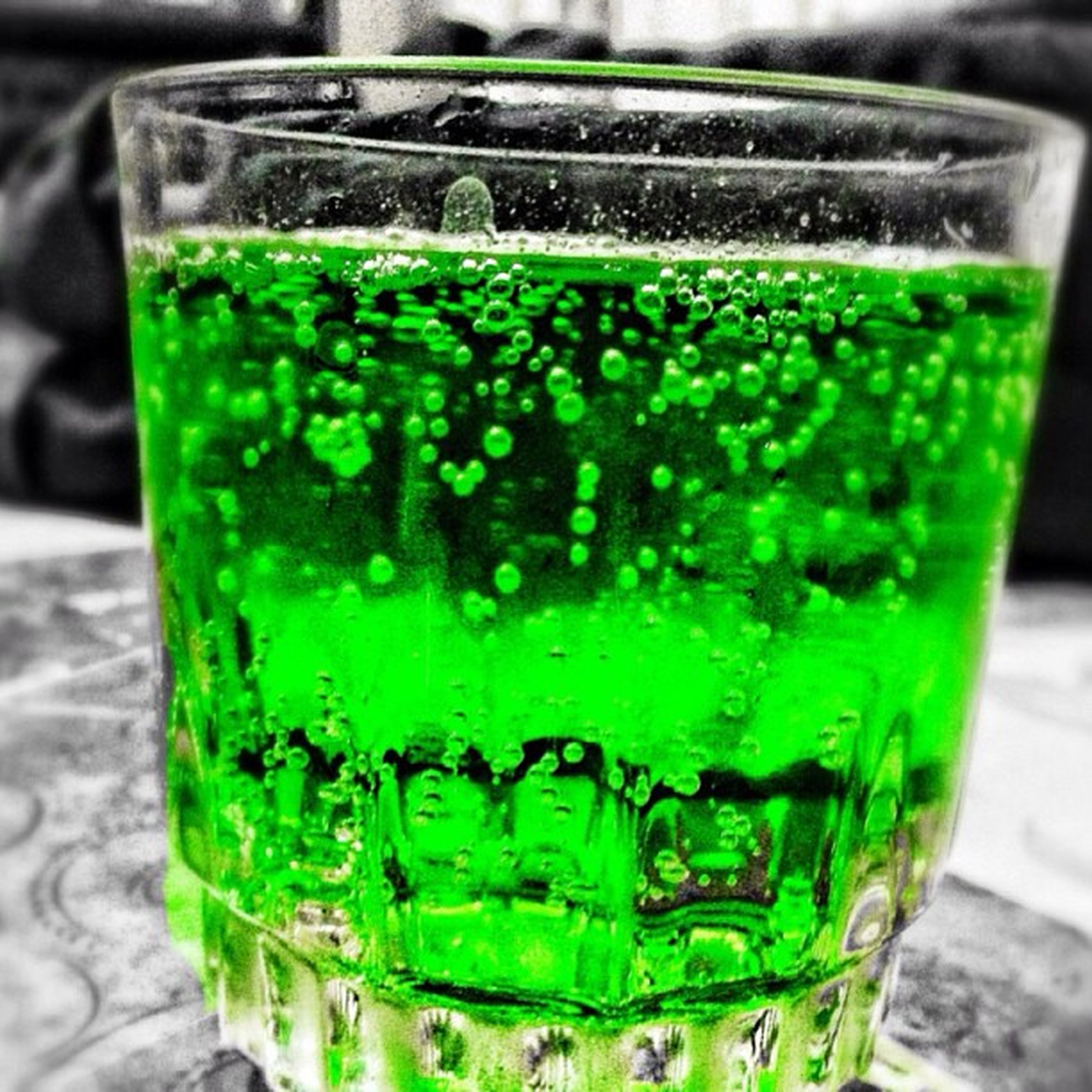 food and drink, drink, close-up, glass - material, green color, focus on foreground, drinking glass, refreshment, still life, freshness, indoors, transparent, alcohol, table, glass, selective focus, no people, cold temperature, bottle, mint leaf - culinary