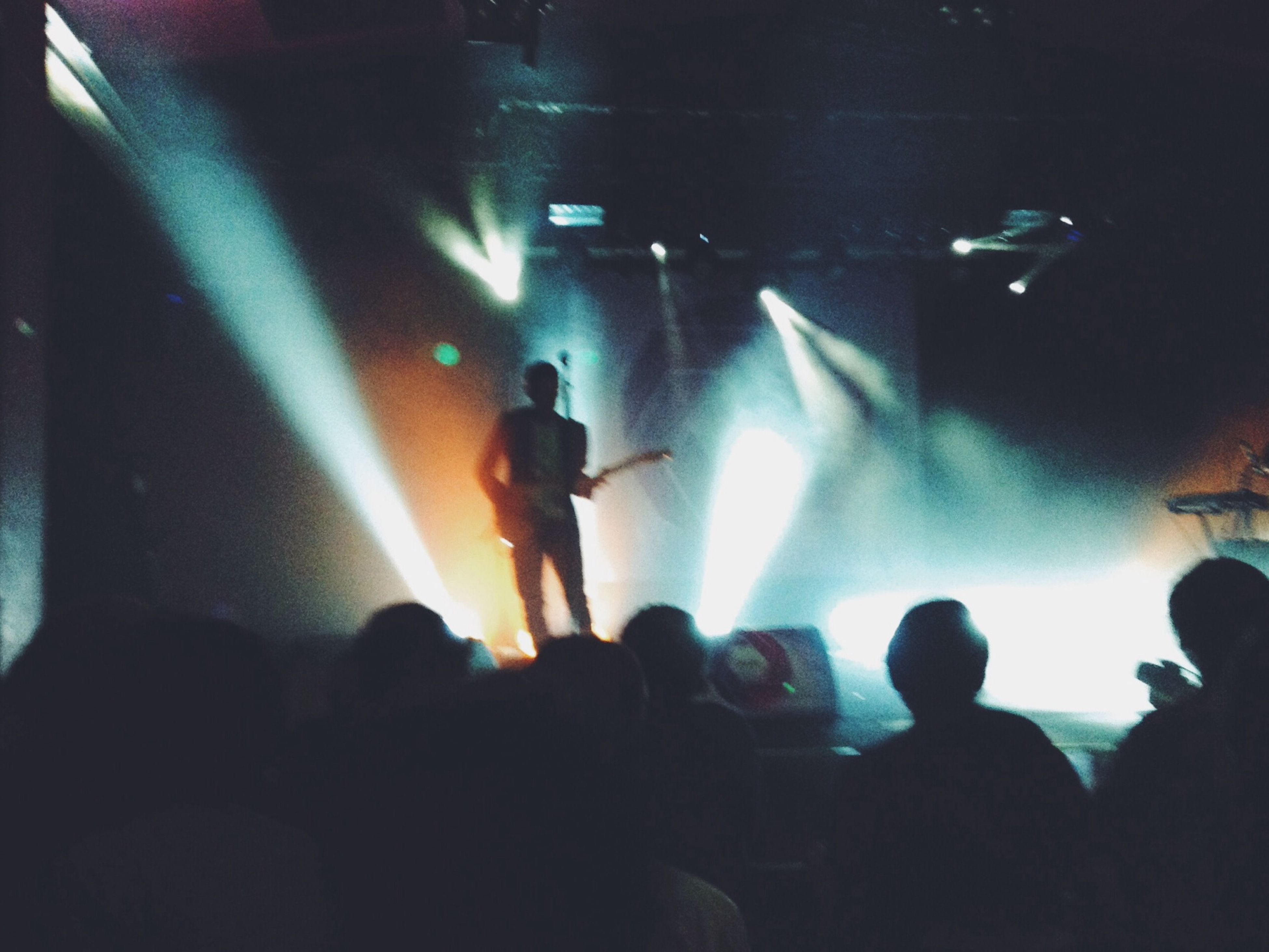 indoors, large group of people, men, lifestyles, illuminated, music, leisure activity, nightlife, person, arts culture and entertainment, enjoyment, crowd, performance, stage - performance space, concert, silhouette, togetherness, light - natural phenomenon