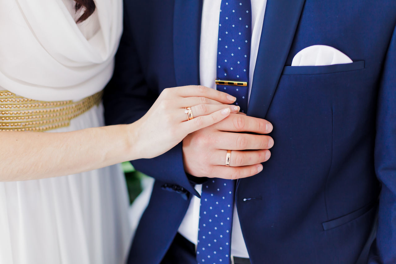 Bride Celebration Event Couple Groom Hands Holding Holding Hands Human Hand Indoors  Life Events Midsection Real People Standing Together Togetherness Well-dressed