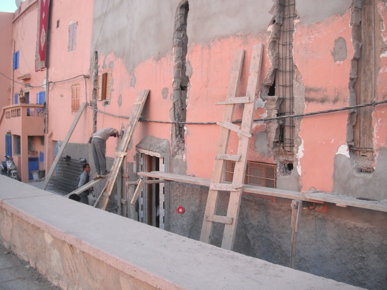 Moroccan surf town. Africa Architecture Backpacker Building Exterior Building Site Built Structure Construction Developing Development Ladder Morocco North Africa Outdoors Pink Repair Urban