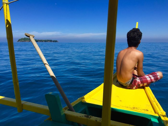 Fishing Boat Fisherman Fisherboy  Tropical Tropical Paradise South China Sea Philippines Painted Wood Brightly Coloured Blue And Yellow Blue Sea And Blue Sky Sea And Sky Sea Desert Island The Week On EyeEm The Week On EyeEm