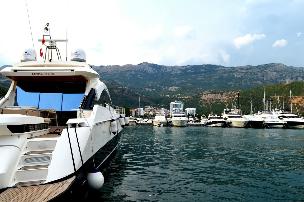 nautical vessel, mode of transport, transportation, moored, boat, yacht, motorboat, mountain, water, harbor, no people, sky, sea, day, mast, nature, outdoors, sailing, yachting