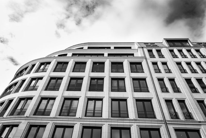 ESSEN, GERMANY - JANUARY 25, 2017: The facade of an office building at Rüttenscheider Straße contrasts with the vivid sky Architectue Black & White Bright Light Essen, Germany Office Building Ouddoor Sunny Urban